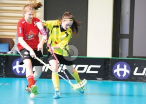 Team captain Hannah Wilson (left) competes for Canada